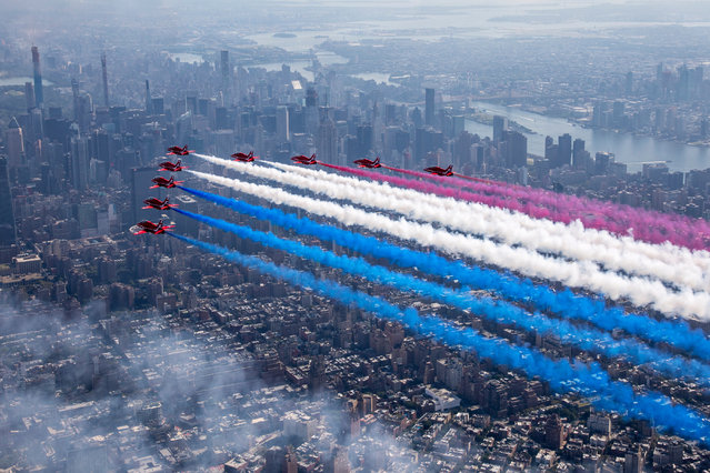 A handout picture provided by the British Ministry of Defence showing aircraft from the British Royal Air Force Aerobatic Team, The Red Arrows streaming the Red, White and Blue joined by the USAF Thunder Birds and a variety of US Air Force Aircraft, including the 5th Generation F-35 and a F-22 Raptor, flying down the Hudson river in New York, USA, 22 August 2019. The Red Arrows are in New York to preform at the New York Air Show 24/25 August 2019. The Royal Air Force Aerobatic Team, The Red Arrows currently deployed on Exercise WESTERNHAWK 2019. It is the first time the Red Arrows have been to North America since 2008 and the deployment will be the most ambitious tour of Canada and the United States ever undertaken by the team – going coast-to-coast. (Photo by Sgt Ashley Keates/EPA/EFE/RAF/British Ministry of Defence)