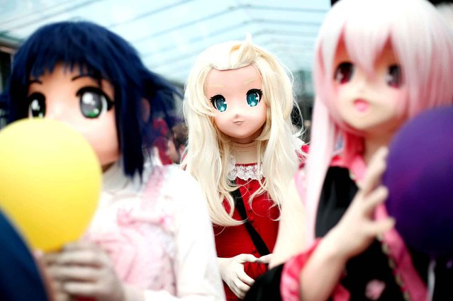 Women dressed like manga characters attend the 16th edition of the Japan Expo exhibition, in Villepinte, north of Paris, Thursday, July 2, 2015. (Photo by Thibault Camus/AP Photo)