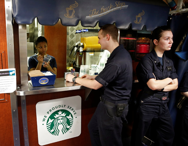 US Navy sailors wait in line for Starbucks coffee on board of the USS Harry S. Truman aircraft carrier in the eastern Mediterranean Sea, June 14, 2016. (Photo by Baz Ratner/Reuters)