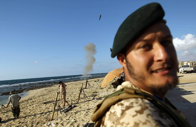 """Members of the self-styled Libyan National Army, loyal to the country's east strongman Khalifa Haftar, fire mortars during clashes with militants in Benghazi's central Akhribish district on July 19, 2017. Libyan military strongman Khalifa Haftar on July 5, 2017 announced the """"total liberation"""" of second city Benghazi, which was overrun by jihadists three years prior. (Photo by Abdullah Doma/AFP Photo)"""