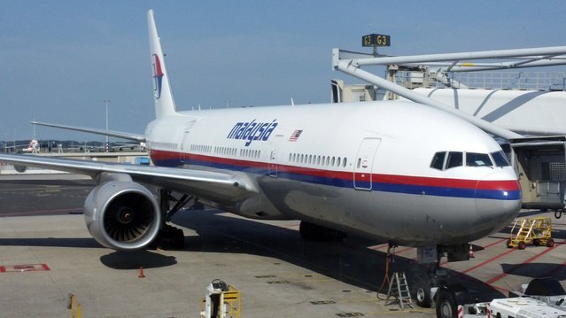 Malaysia Airlines Flight MH-17 is seen at the G3 gate of Schiphol Airport in Amsterdam, before it took off, heading to Kuala Lumpur, July 17, 2014. The Malaysian Boeing 777 airliner was brought down over eastern Ukraine on Thursday, killing all 295 people aboard and sharply raising the stakes in a conflict between Kiev and pro-Moscow rebels in which Russia and the West back opposing sides. (Photo by Yaron Mofaz/Reuters)