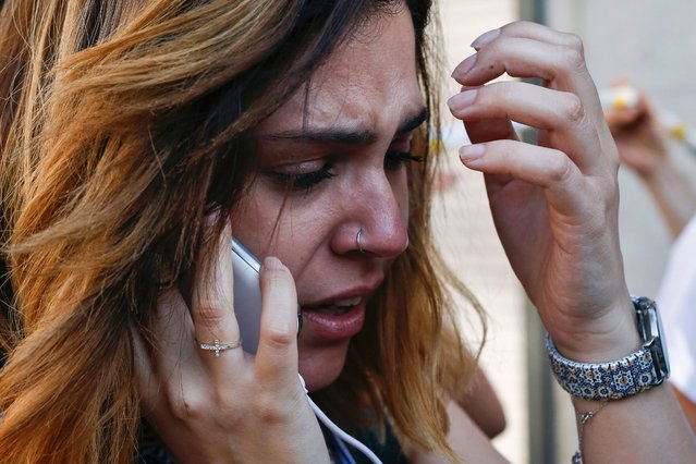 """A woman cries as she phones after a van ploughed into the crowd, killing one person and injuring several others on the Rambla in Barcelona on August 17, 2017. Police in Barcelona said they were dealing with a """"terrorist attack"""" after a vehicle ploughed into a crowd of pedestrians on the city's famous Las Ramblas boulevard on August 17, 2017. Police were clearing the area after the incident, which has left a number of people injured. (Photo by Pau Barrena/AFP Photo)"""