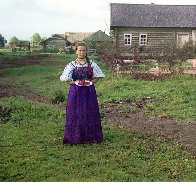 Photos by Sergey Prokudin-Gorsky. Girl with strawberries. Russia, Novgorod province, county Kirillov, 1909