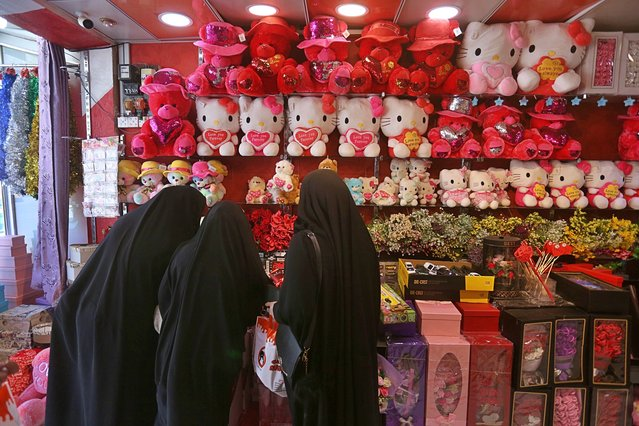 In this Thursday, February 13, 2020 photo, women shop for Valentine's Day gifts in Najaf, Iraq. In recent years, Valentine's in Najaf has emerged as a field of contention. It pitted revelers who see in it harmless fun and personal freedom advocates against conservatives who view it as sacrilege--a foreign celebration that has no place in a holy city like Najaf. (Photo by Anmar Khalil/*AP Photo)