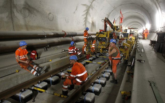 Workers have a break during the installation of the railway tracks in the NEAT Gotthard Base tunnel near Erstfeld May 7, 2012. (Photo by Arnd Wiegmann/Reuters)