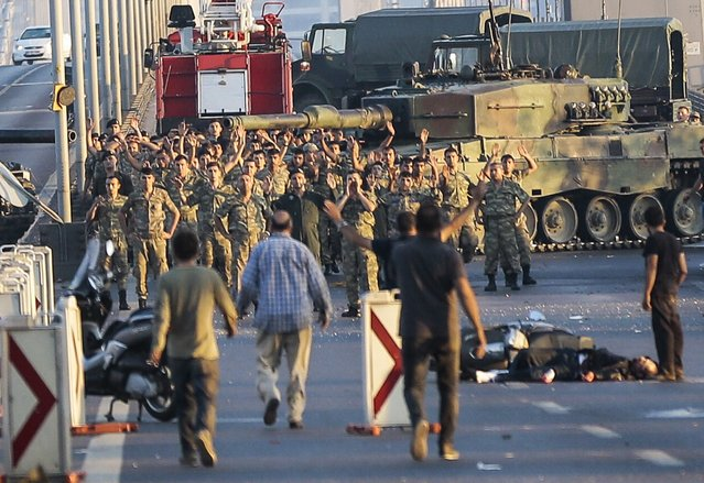 Soldiers involved in the coup attempt in Turkey surrender on Istanbul's Bosphorus Bridge with their hands raised on July 16, 2016. (Photo by Gokhan Tan/Getty Images)
