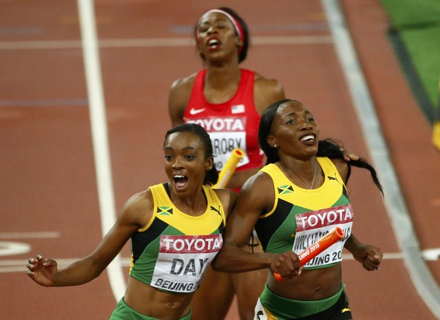 Novlene Williams-Mills of Jamiaca (L) and Christine Day of Jamaica celebrate after crossing the finish line in the women's 4 x 400 metres relay final during the 15th IAAF World Championships at the National Stadium in Beijing, China August 30, 2015. (Photo by David Gray/Reuters)