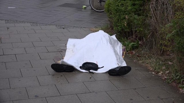In this grab taken from video, a body covered with a sheet outside a mall, in Munich, Germany, Friday,  July 22, 2016. A manhunt was underway Friday for a shooter or shooters who opened fire at a shopping mall in Munich, killing and wounding several people, a Munich police spokeswoman said. The city transit system shut down and police asked people to avoid public places. (Photo by Nonstop News via AP Photo)