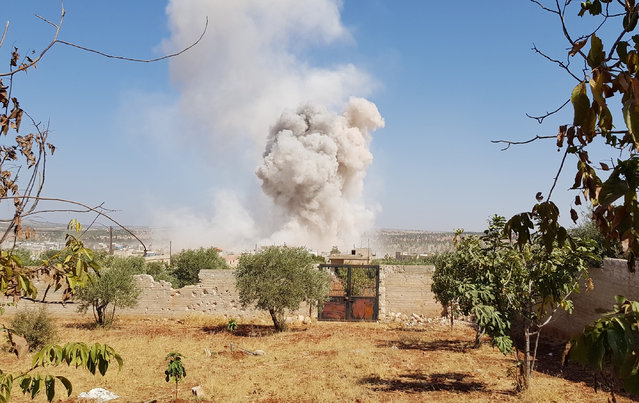 Smoke rises after an air strike was carried out at Kafr Nabil town, which is under control of opponents, in Northern Idlib, Syria on September 19, 2017. (Photo by Firas Faham/Anadolu Agency/Getty Images)