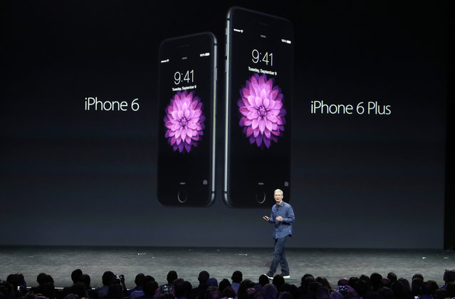 Apple CEO Tim Cook introduces the new iPhone 6 and iPhone 6 Plus on Tuesday, Sept. 9, 2014, in Cupertino, Calif. (Photo by Marcio Jose Sanchez/AP Photo)