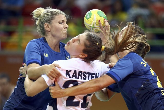 2016 Rio Olympics, Handball, Preliminary, Women's Preliminary Group B Sweden vs Argentina, Future Arena, Rio de Janeiro, Brazil on August 76, 2016. Elke Karsten (ARG) of Argentina is blocked by Frida Tegstedt (SWE) of Sweden and Sabina Rosengren Jacobsen (SWE) of Sweden. (Photo by Marko Djurica/Reuters)
