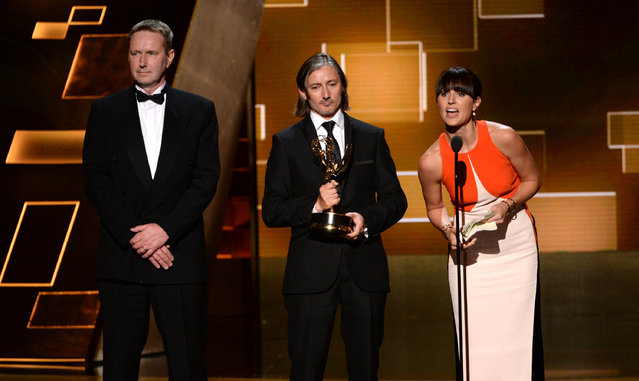 "Richard Dyer, from left, Ronan Hill and Onnalee Blank accept the award for outstanding sound mixing for a comedy or drama series for ""Game of Thrones"" at the Television Academy's Creative Arts Emmy Awards at Microsoft Theater on Saturday, September 12, 2015, in Los Angeles. (Photo by Phil McCarten/Invision for the Television Academy/AP Images)"