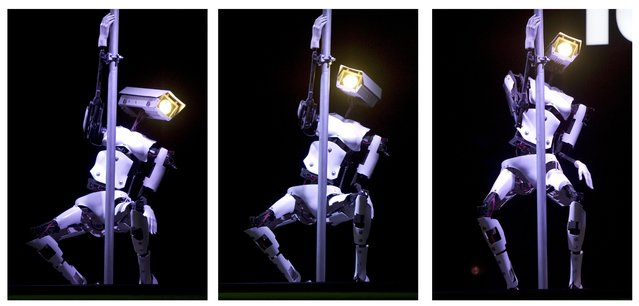 A series of three pictures shows a pole dancing robot at the Tobit Software booth prior to the opening of the CeBIT IT fair in Hanover, Germany, on March 5, 2012. (Photo by Odd Andersen/AFP Photo)