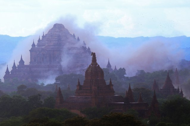 The ancient Sulamani temple is seen shrouded in dust as a 6.8 magnitude earthquake hit Bagan on August 24, 2016. A powerful 6.8 magnitude earthquake struck central Myanmar on August 24, killing at least one person and damaging pagodas in the ancient city of Bagan, officials said. The quake, which the US Geological Survey said hit at a depth of 84 kilometres (52 miles), was also felt across neighbouring Thailand, India and Bangladesh, sending panicked residents rushing onto the streets. (Photo by Soe Moe Aung/AFP Photo)