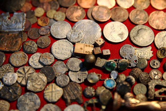 A collection of Tudor coins excavated from the River Thames by mudlark Jason Sandy is displayed at his home in London, Britain June 01, 2016. (Photo by Neil Hall/Reuters)