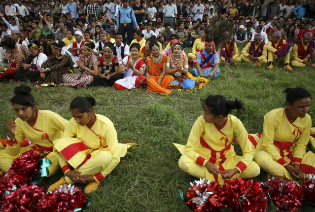 Performers dressed in traditional attire gather during a celebration a day after the first democratic constitution was announced in Kathmandu, Nepal September 21, 2015. (Photo by Navesh Chitrakar/Reuters)