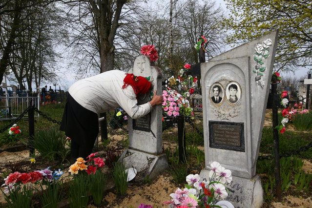 Ekaterina Panchenya visits her relatives' graves during Orthodox Easter. (Photo by Vasily Fedosenko/Reuters)