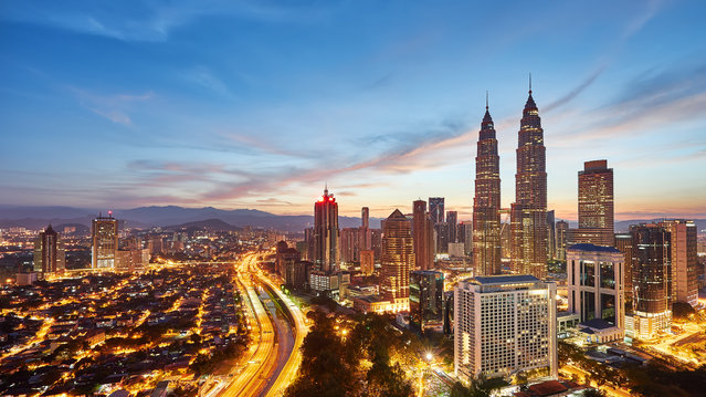 #3. Malaysia, Total GDP: USD 296.4 billion (2016). Contribution of Travel and Tourism to GDP: 13.7%. Here: A view of beautiful sunrise overlooking national landmark of Malaysia, The Petronas Twin Towers. (Photo by Fakrul Jamil Photography/Getty Images)