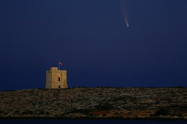 "The Comet C/2020 or ""Neowise"" is seen in the sky behind St Mark's Tower, a 17th century coastal fortification near the village of Bahar ic-Caghaq, Malta on July 12, 2020. (Photo by Darrin Zammit Lupi/Reuters)"