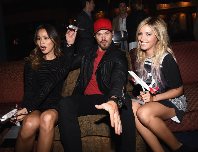 (L-R) Actress Jamie Chung, actor Kellan Lutz, and actress Ashley Tisdale attend the Virgin America Dallas Love Field Launch Celebration at the House of Blues on October 13, 2014 in Los Angeles, California. (Photo by Michael Buckner/Getty Images)