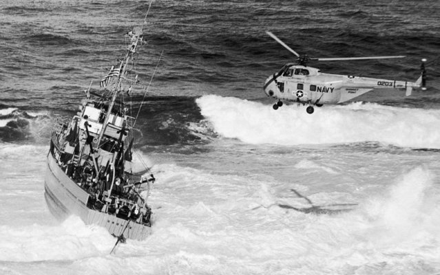 High seas break against the minesweeper Grouse, hard aground on Little Salvages reef off Rockport, Mass., September 25, 1963. A Navy helicopter hovers at right. All crewmen were rescued from 136-foot vessel which piled up on reef at tip of Cape Ann on Saturday. (Photo by AP Photo)