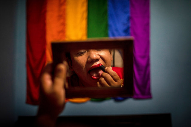 Nepalese Transgender s*x worker Sunita Lama puts on makeup inside her room before going out on the street in Kathmandu, Nepal, 13 July 2020 (issued 21 July 2020). Across South Asia, the LGBTQI community continues to face varying degrees of discrimination. Attitudes are slowly shifting in Nepal and India, where same-s*x unions were decriminalised two years ago. Bu elsewhere across the region, particularly in countries such as Afghanistan, Pakistan, Bangladesh or Sri Lanka, homosexuality is still considered a moral crime amid pervading religious conservatism. (Photo by Narendra Shrestha/EPA/EFE)