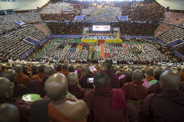 Hardline Buddhist monks and supporters celebrate the recent establishment of four controversial bills decried by rights groups as aimed at discriminating against the country's Muslim minority, with a rally in a stadium at Yangon October 4, 2015. (Photo by Soe Zeya Tun/Reuters)