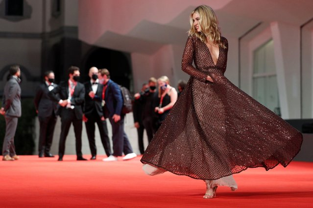 """American actress Isabel May walks the red carpet ahead of the movie """"Run Hide Fight"""" at the 77th Venice Film Festival on September 10, 2020 in Venice, Italy. (Photo by Guglielmo Mangiapane/Reuters)"""