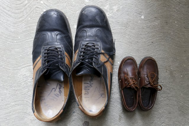 The shoes of Jeison Rodriguez (L), the living person with the largest feet in the world, are seen next to the shoes of his nephew at his house in Maracay, Venezuela, October 14, 2015. Rodriguez, holds the Guinness World Record for the largest feet, with 40.1 cm (1 ft 3.79 in) on the right foot and 39.6 cm (1 ft 3.59 in) on the left foot. (Photo by Carlos Garcia Rawlins/Reuters)