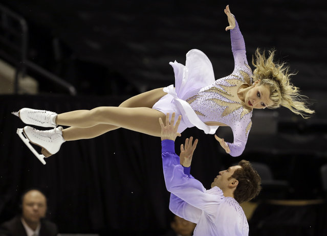 Kirsten Moore-Towers and Dylan Moscovitch, of Canada, perform during the pairs free program at the World Figure Skating Championships Friday, March 15, 2013, in London, Ontario. (Photo by Darron Cummings/AP Photo)
