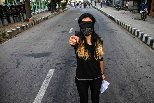 A girl wearing a black band around her face, gesturing during a flash mob against rape in Kathmandu, Nepal on October 10, 2020. Data at the Nepal Police shows 2,144 cases of rape and 687 cases of attempted rape were reported in the fiscal year 2019-20 an increase from 1,480 cases of rape and 727 cases of attempted rape from the fiscal year 2017-18. (Photo by Prabin Ranabhat/SOPA Images/LightRocket via Getty Images)