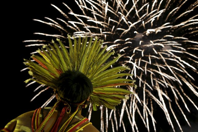 An indigenous man watches fireworks during the closing ceremony of the first World Games for Indigenous Peoples in Palmas, Brazil, October 31, 2015. (Photo by Ueslei Marcelino/Reuters)