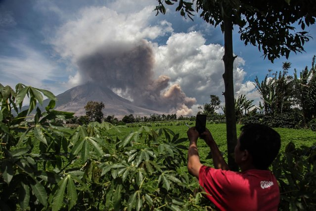 Mount Sinabung continues to spew thick smoke into the air in Karo, North Sumatra on October 30, 2020. (Photo by Albert Ivan Damanik/Anadolu Agency via Getty Images)