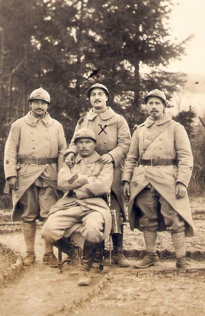 French WWI soldier Edouard Marius Ivaldi (Top centre) poses with fellow soldiers in this 1917 picture. The soldier died for France on April 30, 1917. World War One historians estimate that on the western front half of the fallen soldiers were never found or identified. (Photo by Charles Platiau/Reuters)