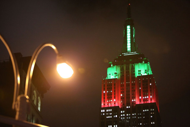 The Empire State Building is seen lit in green and red Christmas colors December 23, 2009 in New York City. Christians worldwide are gearing up for the December 25 holiday honoring the birth of Jesus Christ. (Photo by Mario Tama/Getty Images)