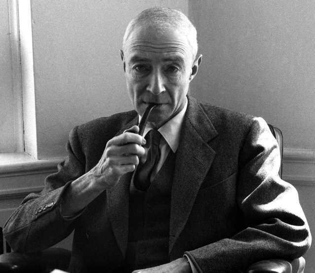 Dr. J. Robert Oppenheimer puffs on a pipe during an interview at the Institute for Advanced Study in Princeton, N.J., April 5, 1963. Oppenheimer, who directed the Manhattan Project that developed the first atom bomb, regretted his participation in the program in his later years. (Photo by AP Photo)