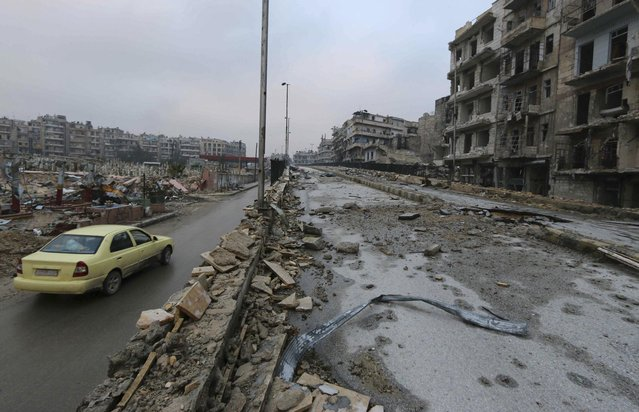 A view shows the damaged bridge of al-Shaar neighbourhood of Aleppo amid damaged buildings December 28, 2014. The bridge is constantly targeted by snipers and shelling by forces loyal to Syria's President Bashar al-Assad. (Photo by Abdalrhman Ismail/Reuters)