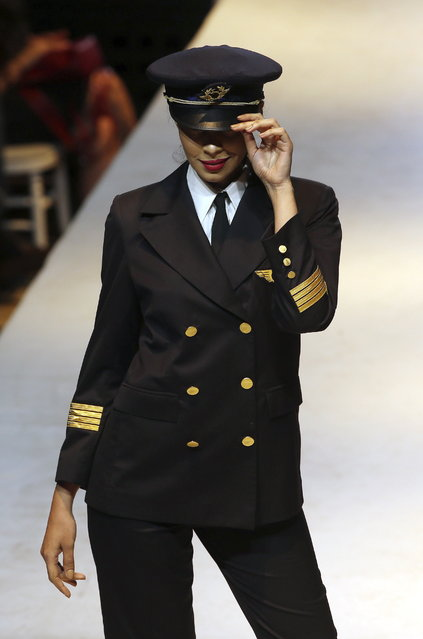 A model exhibits clothes from the 70 years of Tunisair crew uniforms presentation during the Tunis Fashion Week 2018 in Tunis, Tunisia. (Photo by Mohamed Messara/EPA/EFE)