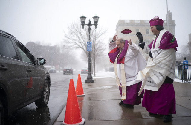 A gust of wind took Archbishop Bernard Hebda's cap off while he and Auxiliary Bishop Andrew Cozzens offered a special Easter Blessings from the Bishops Sunday afternoon on April 12, 2020. (Photo by Jeff Wheeler/Star Tribune via Getty Images)