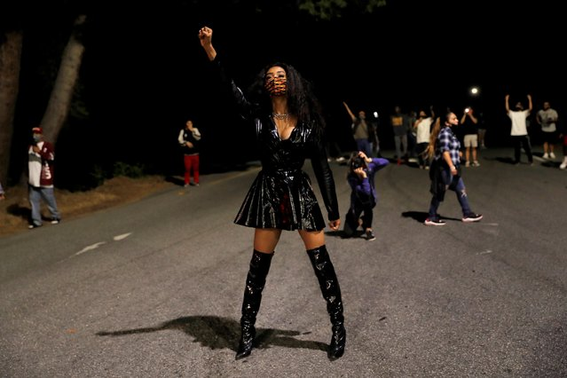 A protester raises her fist at the entrance of Highway 280 and S. 4th St. as people protest the killing of George Floyd in Minneapolis in downtown San Jose, Calif., on Friday, May 29, 2020. (Photo by Nhat V. Meyer/Bay Area News Group)