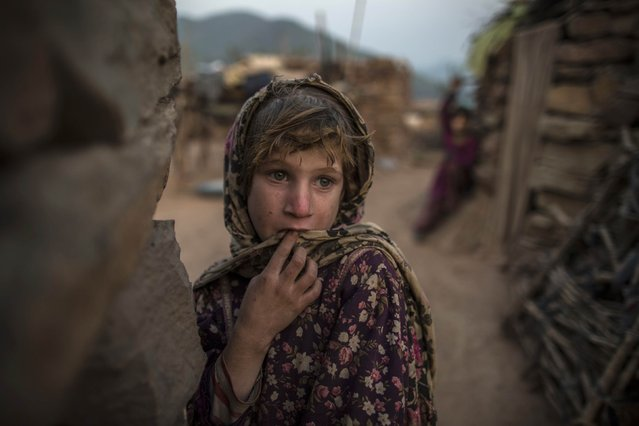 Soniya, 6, whose family moved to Islamabad from Pakistan's Khyber-Pakhtunkhwa province to look for work, stands outside their house on the outskirts of Islamabad January 1, 2015. (Photo by Zohra Bensemra/Reuters)