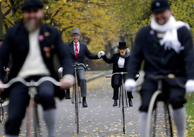 Participants wearing historical costumes ride their high-wheel bicycles during the annual penny farthing race in Prague, Czech Republic November 5, 2016. (Photo by David W. Cerny/Reuters)