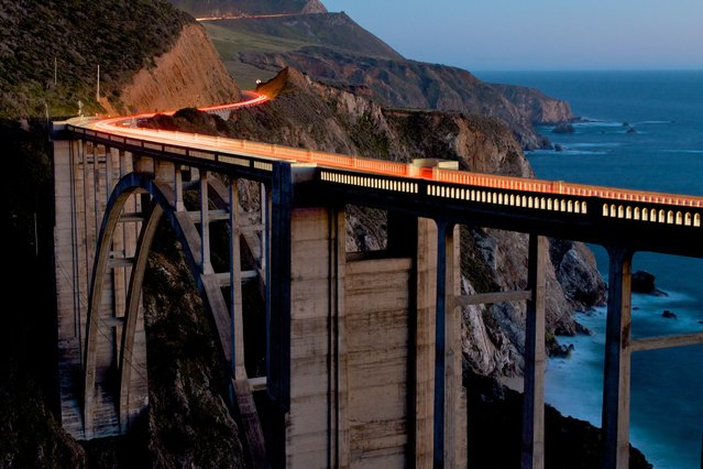 """The Bixby Bridge at dusk"". The Bixby Bridge has been an icon on the Big Sur coastline since 1932. It is amazing that something man-made could blend so well into such an incredible environment. Location: Big Sur, CA. (Photo and caption by Doug Croft/National Geographic Traveler Photo Contest)"