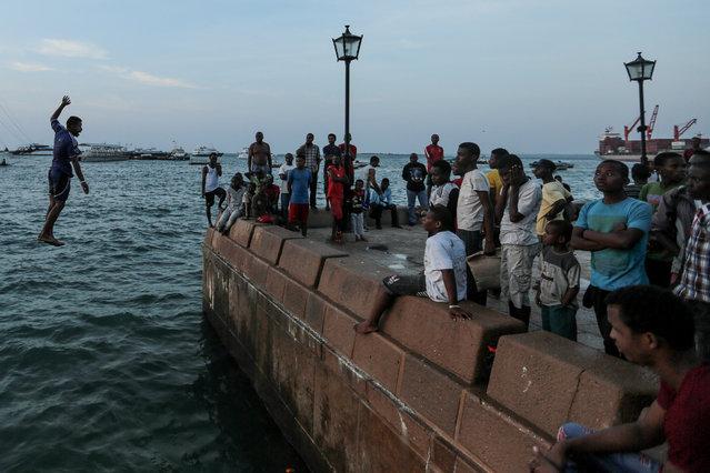 Zanzibari youth jump into the Indian Ocean from Forodhani Gardens park in the historical city of Stone Town, Zanzibar, Tanzania, on Wednesday, January 21, 2015. (Photo by Mosa'ab Elshamy/AP Photo)