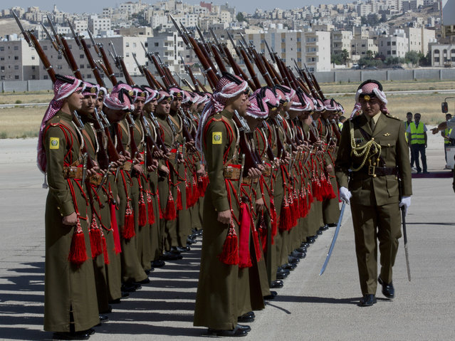 A Jordanian army officer inspects the honor guard in preparation for the arrival of Britain's Prince William, at Marka Airport in Amman, Jordan, Sunday, June 24, 2018. Britain's Prince William kicked off a politically delicate five-day tour of Jordan, Israel and the Palestinian territories. He plans to meet with young people, refugees and political leaders in a tumultuous region Britain had controlled between the two world wars. (Photo by Nasser Nasser/AP Photo)