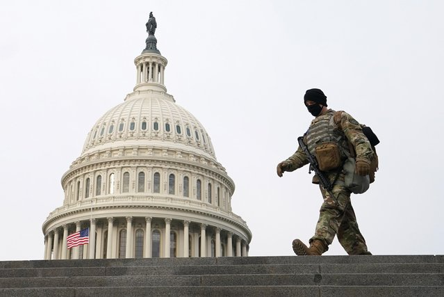 A National Guardsman walks the grounds of the U.S. Capitol on the second day of U.S President Donald Trump's second impeachment trial in Washington, U.S., February 10, 2021. (Photo by Kevin Lamarque/Reuters)