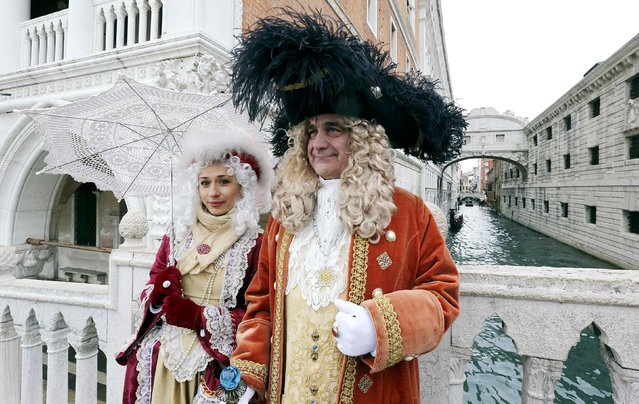 Revellers pose in front of the Ponte dei Sospiri (Bridge of Sighs), during the first day of the Venice Carnival, February 1, 2015. (Photo by Stefano Rellandini/Reuters)