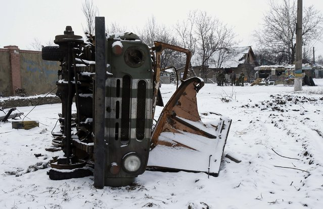 A military car, damaged during fighting between pro-Russian rebels and Ukrainian government forces, is seen on the roadside in the town of Vuhlehirsk, eastern Ukraine February 10, 2015. (Photo by Maxim Shemetov/Reuters)