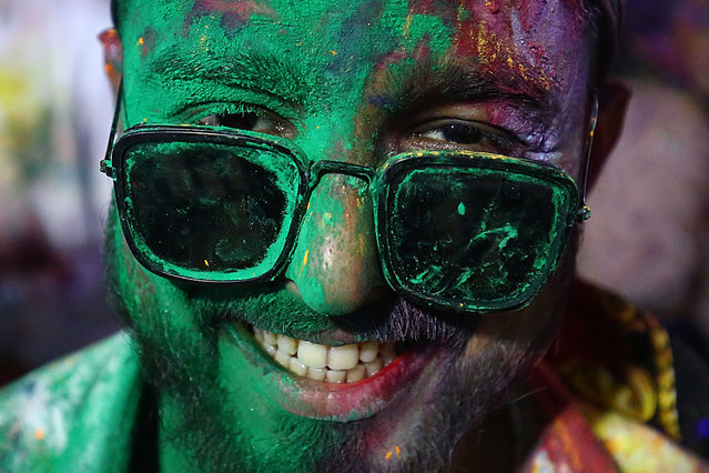 "A member of the Pakistani Hindu community with his face covered in colors celebrates the festival of Holi in Karchi, Pakistan, 28 March 2021. ""Holi"" is an ancient Hindu festival symbolizing the victory of good over evil as well as the arrival of spring. Revellers celebrate Holi by covering each other in colored powders. (Photo by Shahzaib Akber/EPA/EFE)"