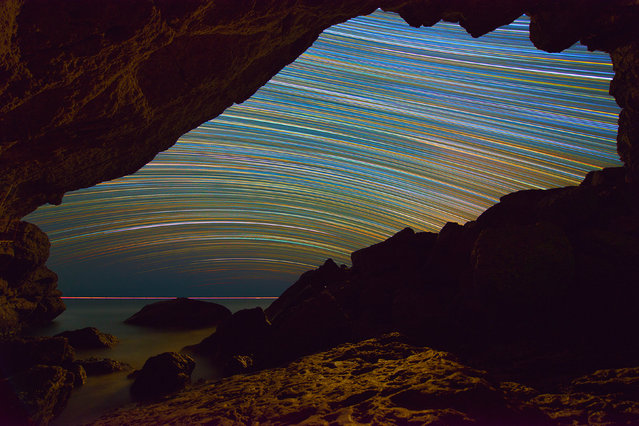 Vibrate, colorful star trails through a cave. (Photo by Evgeniy Zaytsev/Caters News)